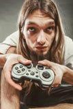 Foyer masculin de joueur sur des jeux de jeu Photo libre de droits