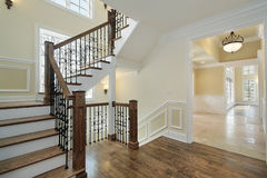 Foyer in new construction home. With wood staircase Stock Image