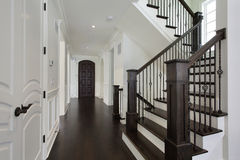 Foyer in new construction home. With dark wood staircase Royalty Free Stock Photo