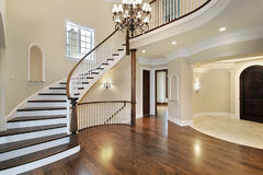 Foyer in new construction home. With circular staircase Stock Photos
