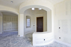 Foyer in a Newly Constructed House. New drywall ready for paint in a n entryway Royalty Free Stock Photo