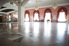 Foyer for spectators in the theater. Of a multi-colored marble floors, columns and large windows royalty free stock image
