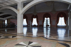 Foyer for spectators in the theater. Of a multi-colored marble floors, columns and large windows stock photo