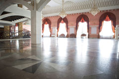 Foyer for spectators in the theater. Of a multi-colored marble floors, columns and large windows stock photography