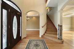 Foyer with stain glass door Stock Images