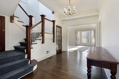 Foyer in traditional home. With brown and white staircase stock images