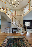 Foyer with wood trim railing Stock Images