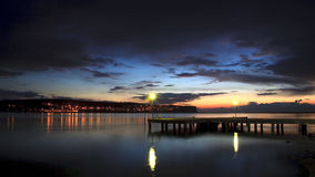 Foz do Arelho, the obidos lagoon, portugal. The old pier at foz do arelho in a calm evening just after sunset in the obidos lagoon, bom sucesso, with some stock photos