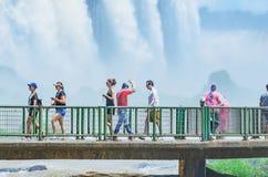 Tourists on the footbridge of the Cataratas do Iguacu. Foz do Iguacu, Brazil - January 07, 2018: Tourists on the footbridge of the Cataratas do Iguacu. The Royalty Free Stock Photo