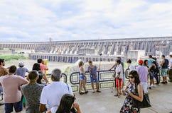 Tourists taking photos of the Itaipu dam. Foz do Iguacu, Brazil - January 08, 2018: Tourists visiting and taking photos of the Itaipu dam, a huge binacional Royalty Free Stock Photos