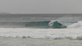 60fps clip of a surfer dropping in on another surfer at Kirra on the gold coast of Queensland