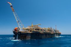 FPSO oil rig vessel with gas flare stock photo