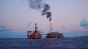FPSO tanker vessel near Oil Rig platform. Offshore oil and gas industry