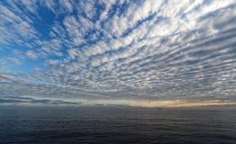 FPSO under a mackerel sky in the north sea stock photo