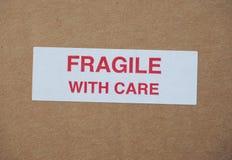 Frágil assine com cuidado Fotos de Stock Royalty Free