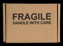 Frágil dirija con la etiqueta de la etiqueta de cuidado Imagenes de archivo