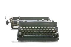 främre bärbar skrivmaskinssiktstappning Arkivfoton