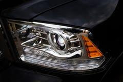 Främre ljus för bil i closeup Arkivbilder