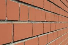 Främre närbildsikt av en tegelstenvägg på en 45 grad vinkel Arkivbild