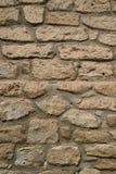Främre sikt av den gamla stenväggen i efterrättstaden av nordliga Chile, Sydamerika fotografering för bildbyråer