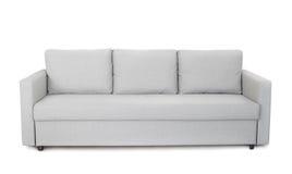 Främre sikt av den gråa soffan arkivfoton