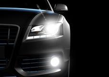 Främre sikt av den lyxiga bilen i en svart bakgrund Royaltyfri Foto