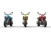 Främre sikt för tre sportmotorcyklar i rad - royaltyfri illustrationer