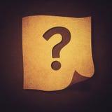 Fråga i papper Arkivbild