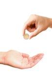 fråga myntet som ger handen till Royaltyfria Bilder