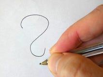 ? Frågefläck - handstilhand arkivfoton