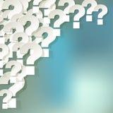 Frågefläckar som är vita i hörnet på en blå bokehbakgrund Arkivbilder