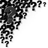 Frågefläckar svärtar i hörnet på en vit bakgrund Royaltyfri Foto