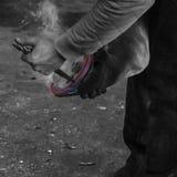 Från smedjan till foten Arkivfoto