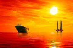 Frånlands- olje- område på soluppgång fotografering för bildbyråer