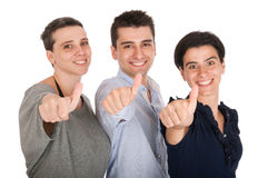 Frère et soeurs affichant des pouces vers le haut Image stock