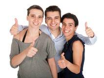 Frère et soeurs affichant des pouces vers le haut Image libre de droits