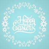 Fröhliche Ostern auf dem blauen Hintergrund stockbild