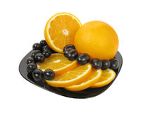 Früchte auf Teller Stockbilder