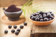 Früchte und acai powde Stockfoto