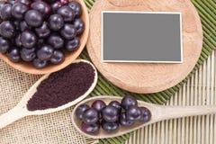 Früchte und acai Pulver Stockfotografie