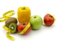 Früchte und messendes Band Stockfoto
