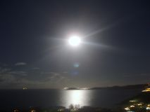 Früher Morgen moonset, Abnutzungsschatten! Stockbilder
