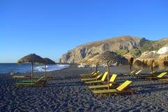 Früher Morgen Santorini-Strandes, Griechenland Stockfotos