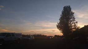 Früher Sonnenuntergang Stockbild