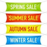 Frühling, Sommer, Herbst, Winterschlussverkauffahnen Lizenzfreie Stockfotos