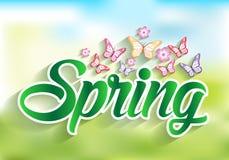 Frühlings-Wort-Papier geschnitten mit Blumen u. Schmetterlingen Stockfotos