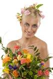 Frühlingsfrau mit Blumen Stockbild