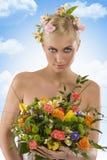 Frühlingsfrau mit Blumen Lizenzfreies Stockfoto
