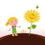 Frühlingsgartenarbeit: Gärtnerkind mit Sonnenblume Stockbild
