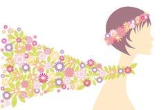 Frühlingsmädchen mit Blumen Stockfotos